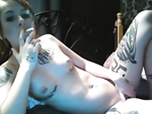 Hot tattoed smocking slut fucks dildo greater than cam