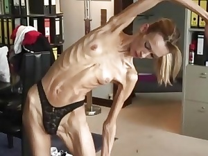 Anorexic blonde girl Inna peels off and showcases her flexible bod