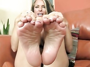 Delicious looking stunner is unveiling her feet and is ready to give foot wank