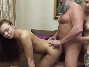 A blond and a brunette in senior and young threeway hard fuck tape