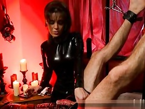 Naughty lady is manhandling this boy pouring paraffin wax on his monstrous cock