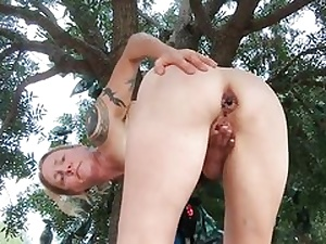 Hot damsel stretches her gams out broad and is fingerblasting her fuck holes