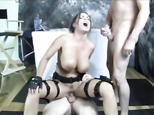 Mischievous Lara Croft with big knockers gets fucked by two horny guys
