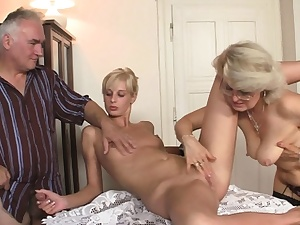 Mature woman munches her youthfull pussy before aged threesome