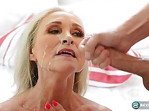 Lusty light-haired female, Katia is wringing her meaty globes while getting slammed with 2 penises